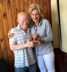 Daressalam Tanzania - Sonja Dinner with a young Albino widower who will get professional training and support for his child