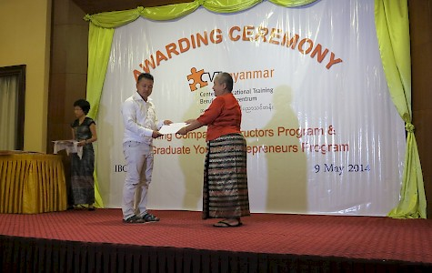 Myanmar - E4Y: Handing over of the final diploma to a schoolgirl by headmistress Daw Htet Htet Ye Win